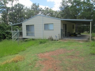 HOME ON APPROX 12 ACRES AT WOLVI WITH AIR-CON
