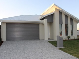 PELICAN WATERS FAMILY HOME
